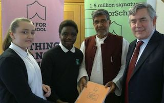 1.5m sign #UpForSchool as students hand signatures to Kailash Satyarthi and Gordon Brown