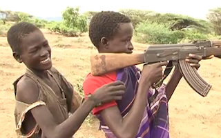 Missing out on school: Kenyan boys who carry guns to protect their villages