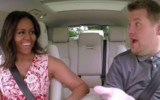 Michelle Obama sings the praises of girls' education with TV host James Corden