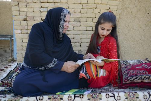Aqeela Asifi teaches her daughter Sawera UNHCR/S. Rich.JPG