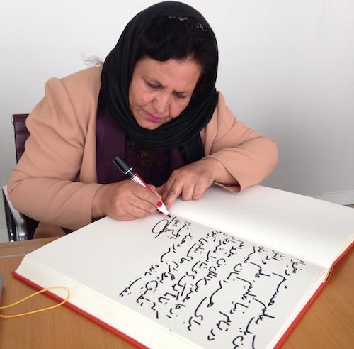 Aqeela Asifi signs the #UpForSchool Petition book