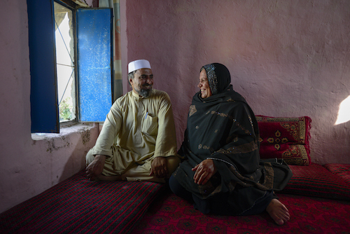 Aqeela Asifi with her husband Sher Muhammad in their home he has championed her work with refugee girls from the beginning UNHCR:S. Rich