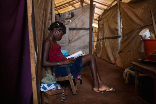 Central African Republic Alison aged 14 reads a book at for internally displaced people in Bangui picture by UNICEF/Bindra