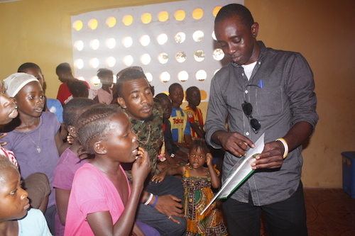 Chernor Bah reads to Ebola orphans in Sierra Leone