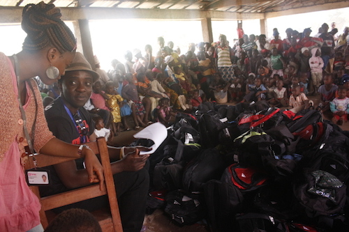 Chernor Bah with schools supplies to distribute to Sierra Leone children