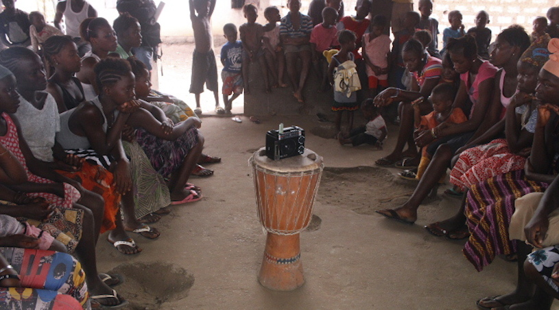 Chernor on Ebola -girls club listen to lesson on radio.jpg