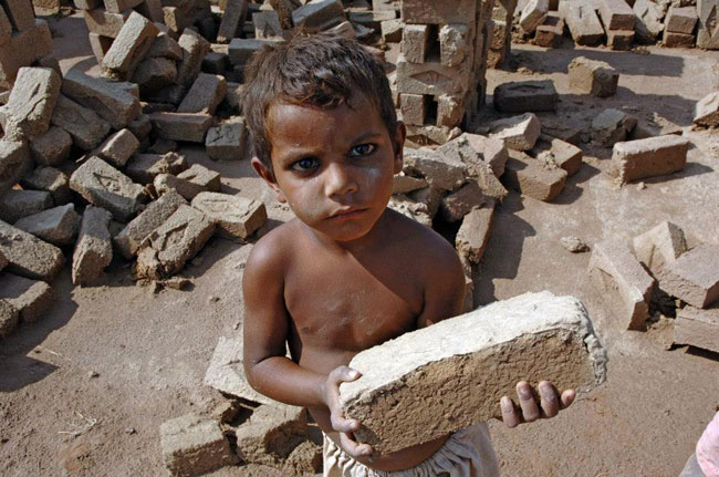 Child labour - a bonded brick maker in Pakistan picture by UN