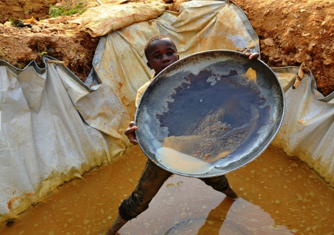 A boy working at a gold mine in Democratic Republic of Congo