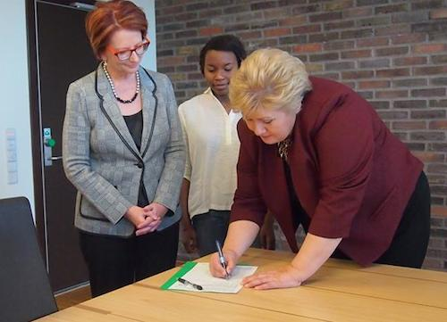 Norway PM Erna Solberg signs #UpForSchool Petition watched by Julia Gillard and Hellen Griberg