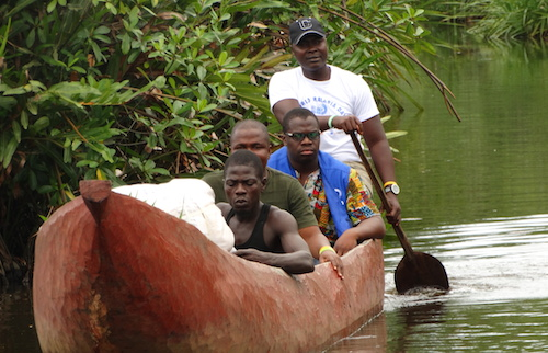 GYA from Liberia Moses Owen Brown crossing river to a school in rural area to get UpForSchool signatures