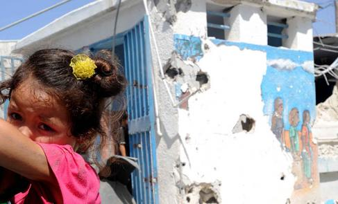 Child at damaged Gaza school