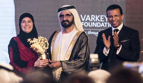 Global Teacher Prize winner 2016 Hanan Al Hroub receives her award from Sheikh Mohammed bin Rashid Al Maktoum