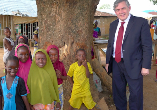 Gordon Brown with school children in Abuja, Nigeria