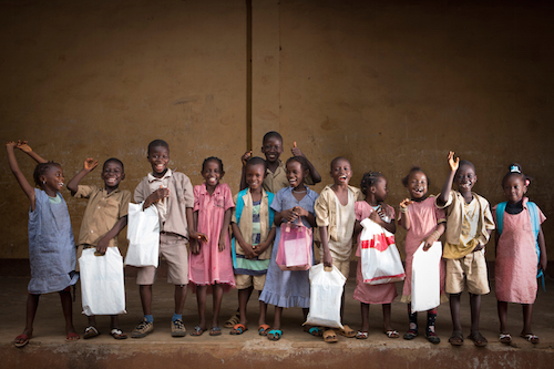 Children in a classroom in Guinea with new education kits Picture: UNICEF/Hyams