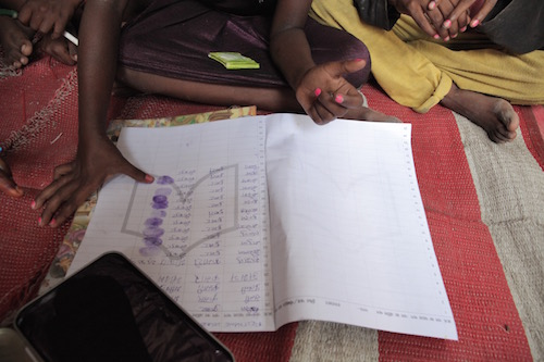 Indian rag picking children sign #UpForSchool Petition with thumb prints