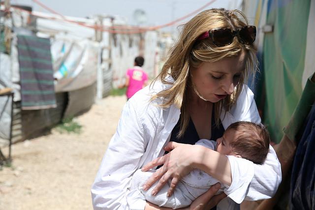 Laura Carmichael cradles 2 month old baby born in Houch El-Oumara tented settlement, Bekaa Vally, Lebanon