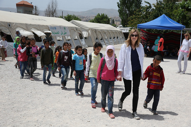 Laura Carmichael in the Bekaa Vally Lebanon, with Syrian children out of school