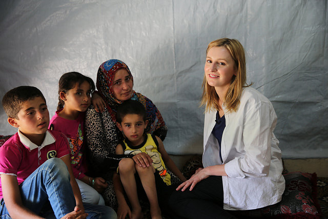 Laura Carmichael speaks to Kawsar, with her children, Jamal (11 years), Cedra (9 years) and Mohamed (5 years), all have been out of school for over a year. In Houch El-Oumara tented settlement, Bekaa Vally, Lebanon