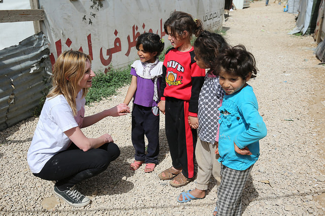 Laura Carmichael speaks to out of school children in Houch El-Oumara tented settlement, Bekaa Vally, Lebanon