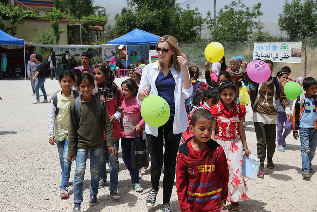 Laura Carmichael with out of school children in Houch El-Oumara tented settlement, Bekaa Vally, Lebanon