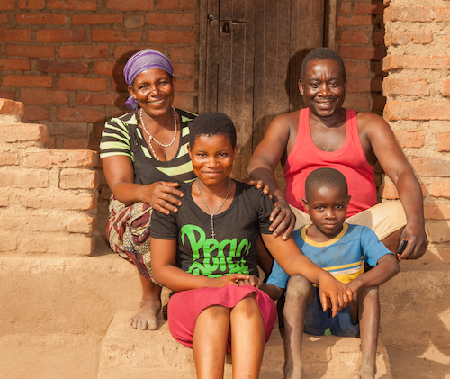Malawi child marriage - Salome at home with her parents and son Andrew