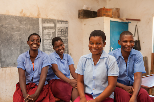Malawi child bride Salome Mbughi with her school friends picture by Tearfund/Chris Hoskins