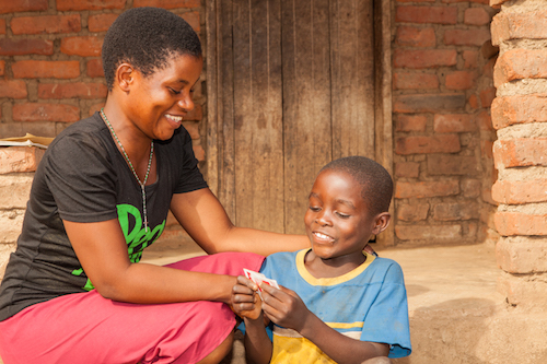 Malawi child marriage - Salome with her son Andrew picture by Tearfund/Chris Hoskins