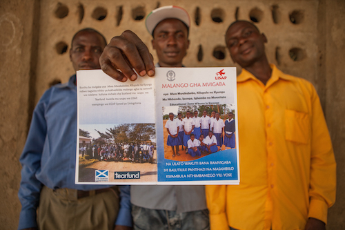 Malawi child marriage - chiefs show the by-laws picture Tearfund/Chris Hoskins