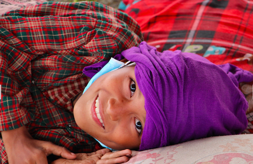Nepalese boy at camp after earthquake picture OCHA/Orla Fagan