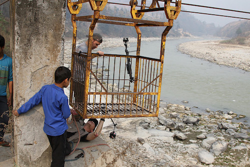 Nepal film crew crew set up their equipment at river crossing in Dhading district Picture: Lauren Ciel