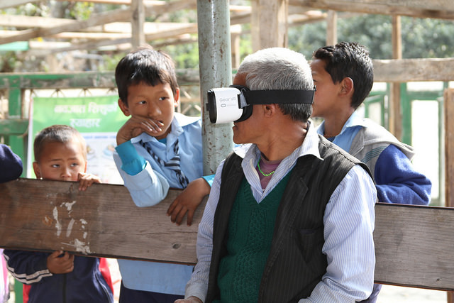 A villager tries on the VR headset in Sindhupalchok Picture: A World at School/Claire Wilkinson