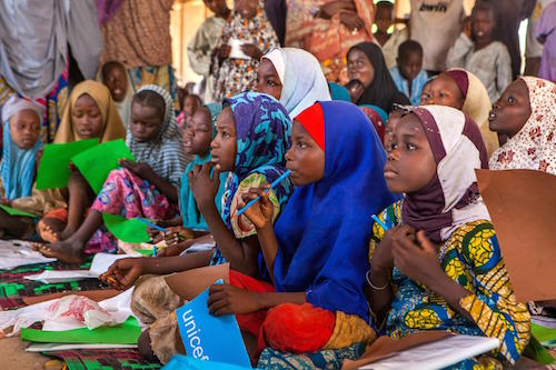 Nigerian girls at UNICEF-supported safe space in camp for displaced near Maiduguri picture UNICEF/Esiebo