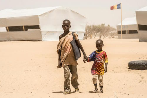 Nigerian refugees Bello aged 12 and Alei Kolo at camp in Lake area of Chad picture by UNICEF/Cherkaoui