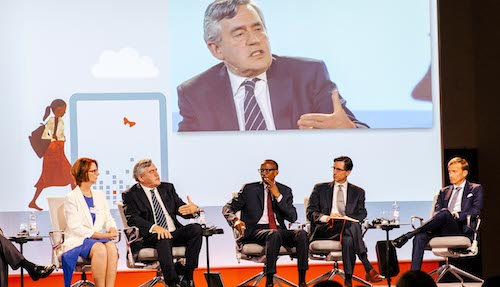 Gordon Brown in a panel discussion on stage at Oslo Education Summit
