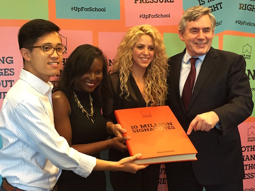 Shakira and Gordon Brown with GYAs Dawnique Shury from Guyana and Benedict Joson from the Philippines