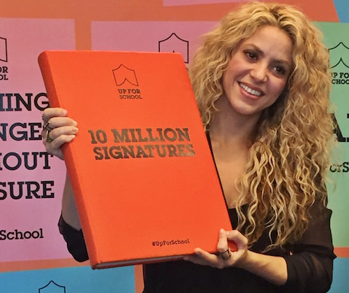Shakira with #UpForSchool Petition book in New York