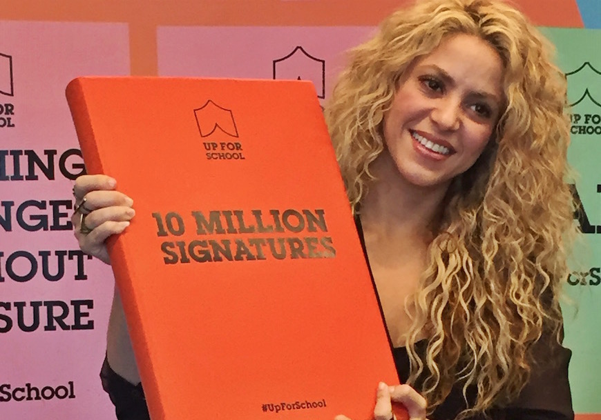 Shakira with #UpForSchool Petition book