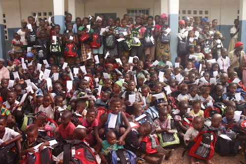 Sierra Leone Ebola orphans with donated school bags and supplies