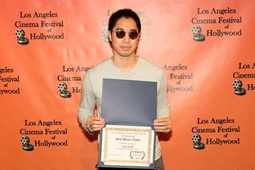 Steve Nguyen with award from Los Angeles Cinema Festival of Hollywood