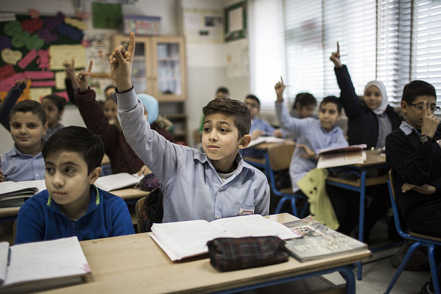 Syrian and Lebanese students sit together in classes at a mixed Elementary public school in Beirut Lebanon picture by Adam Patterson Panos DFID