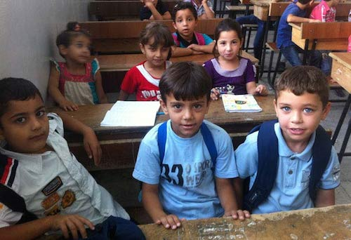 Syrian schoolchildren at their desks UNICEF photo