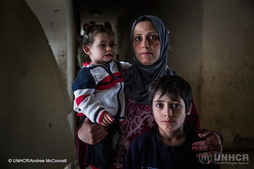 Syrian family at a shelter for IDPs in Latakia picture by UNHCR:Andrew McConnell