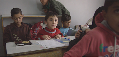 Syrian rapping boy Mohammed aged 9 in Jarrahieh Public School in Bekaa Valley Lebanon