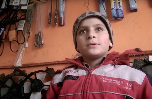Syrian refugee Abdelsalam works as a mechanic aged 12