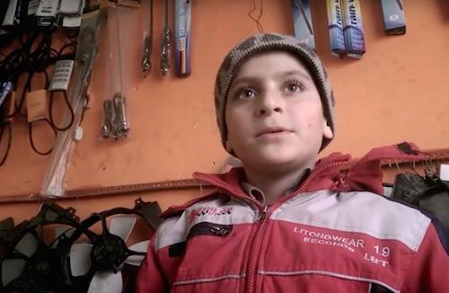 Syrian refugee Abdelsalam works as a mechanic aged 12