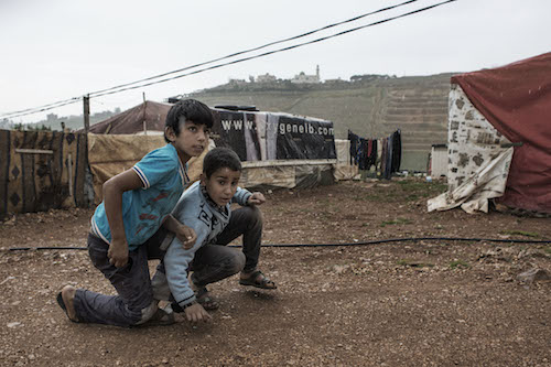 Syrian refugee boys at camp in Lebanon