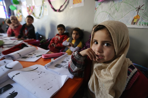 Syrian refugee children attend tented class in refugee camp in Bekaa Valley Lebanon picture by Joseph Eid/AFP/Getty Images/