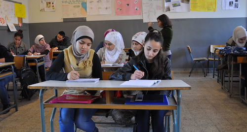 Syrian refugees at a double shift system school in Lebanon picture A World at Schoo
