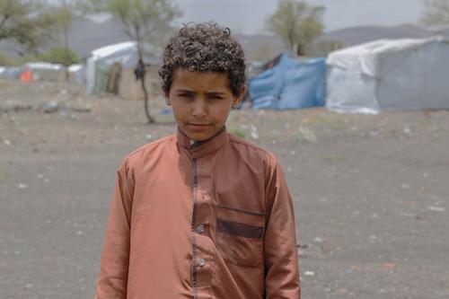 Yemeni boy Elias Jameel Abdullah Mohammed Moqbil Alhakimi, aged 14 at IDP camp near Sana'a picture UNICEF Fuad