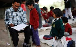 Shopkeeper who teaches Indian slum children at his school under a bridge